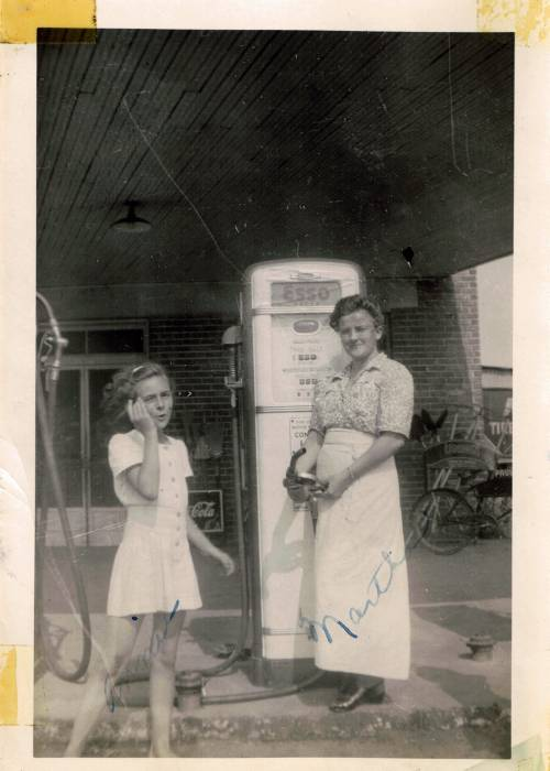 My mother with an employee of my Pa-pa's Plee-zing Food Store (1944)